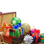 Christmas decorations, balloons and gifts in a wooden box