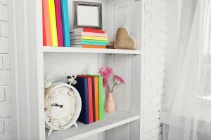Organized shelf with books and decor